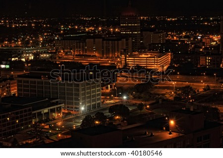City lights of buildings in the evening from a birds view - stock photo