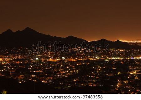 City lights of Phoenix at night, Arizona USA - stock photo