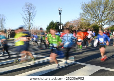 City marathon with runners in motion blur - stock photo