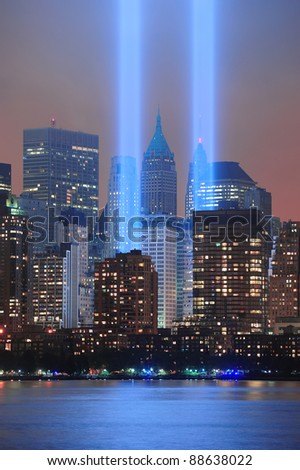 City night view with light beam  lit at the site of  World Trade Center on September 11, 2011 in Manhattan, New York City. - stock photo