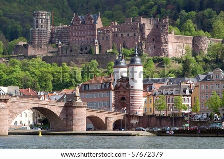 City of Heidelberg (Germany) - view over the old town of Heidelberg including the castle and the old bridge - stock photo