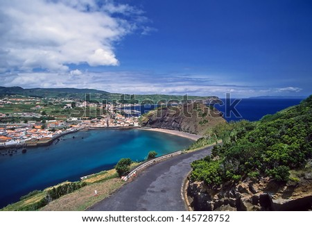 City of Horta, Faial Island, Azores, the Bay of Porto Pim and Horta, marina, Monte Escuro and Monte da Guia. This is a popular tourist and sailing destination in the Atlantic Ocean. - stock photo