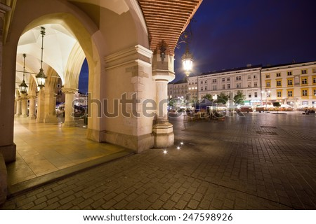 City of Krakow in Poland by night. Arcade of the Cloth Hall on the Main Square in the Old Town. - stock photo