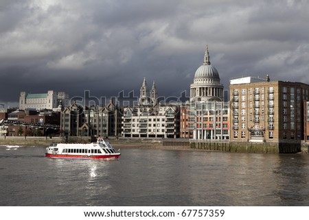 City of London, Financial District seen from the River Thames at twilight - stock photo