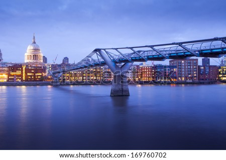 City of London, Millennium bridge and St. Paul's cathedral, Church at night, England, UK  - stock photo