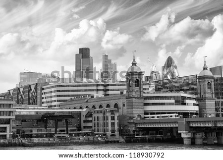 City of London one of the leading centers of global finance and Canary Wharf at the background -UK - stock photo