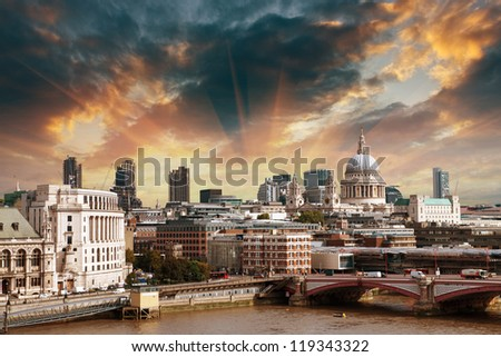 City of London one of the leading centers of global finance and St Paul Cathedral on foreground. - stock photo