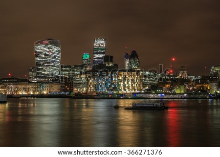 City of London skyline and the river Thames at night.  - stock photo