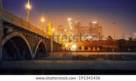City of Los Angeles at night. Scenic view of downtown skyline with bridge in foreground. - stock photo