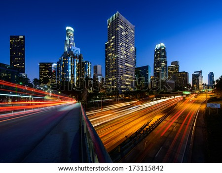 City of Los Angeles California at sunset with light trails. Los Angeles downtown. Los Angeles City. Los Angeles highway. Los Angeles at night. Los Angeles skyscrapers. - stock photo