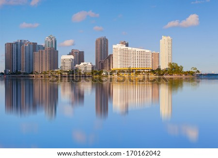 City of Miami, Florida cityscape of downtown  business and residential buildings reflected in Biscayne Bay on a beautiful summer day  - stock photo