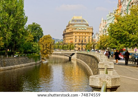 City of Prague, Vltava river arm and National Theatre in the middle in Czech Republic - stock photo