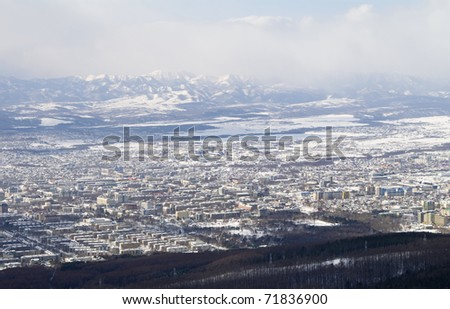 city of Yuzhno-Sakhalinsk, general view from height of the bird's flight - stock photo