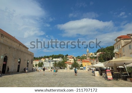 City on island Hvar in Croatia. People walk on promenade. Photo taken in July 22, 2014. in Hvar.