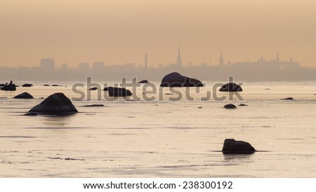 City on the horizon covered with evening haze - stock photo