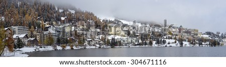 City on the Lake St. Moritz with the first snow in the autumn - stock photo