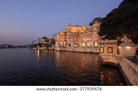 City Palace and Lake Pichola right after sunset in Udaipur, Rajasthan, India - stock photo