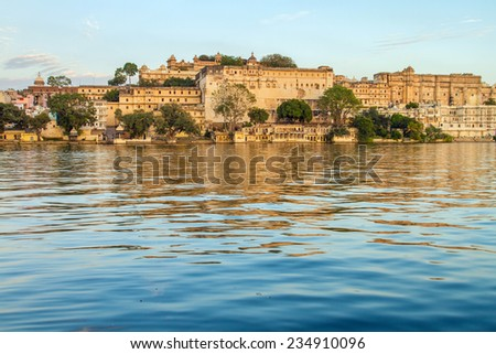 City Palace and Pichola lake in Udaipur, Rajasthan, India - stock photo
