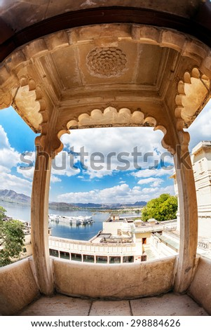 City Palace with Lake Pichola view at blue cloudy sky in Udaipur, Rajasthan, India - stock photo