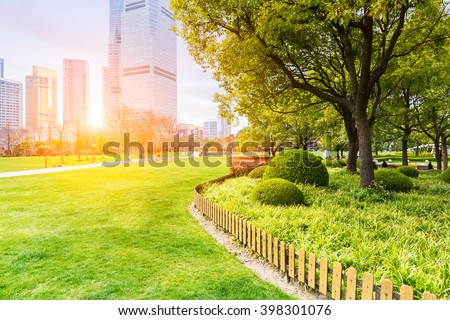 city park in shanghai ,  lujiazui central greenland in sunlit meadows. - stock photo