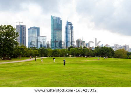 city park with modern building background - stock photo