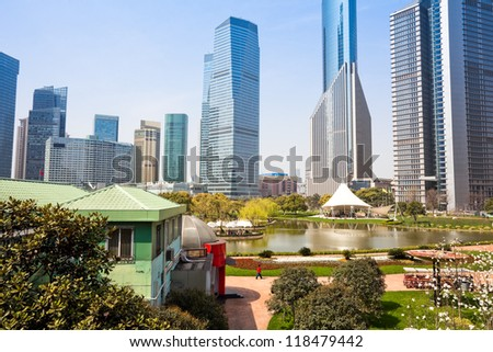 city park with modern building background in shanghai - stock photo