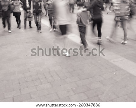 City pedestrians walking street during rush hour in urban business area