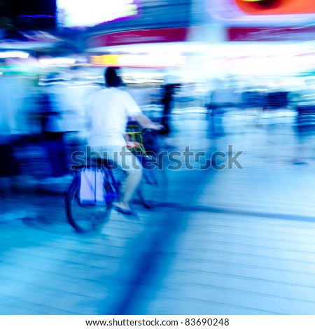 city people on bicycle blur motion - stock photo