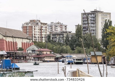 city river landscape with buildings and boats
