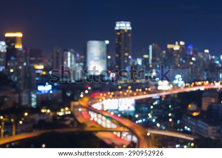 City road intersection night light, blur bokeh background - stock photo