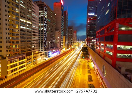 City road tunnels light trails of modern landmark buildings backgrounds in HongKong - stock photo