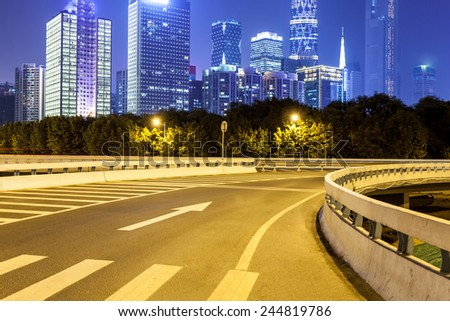 city road with modern buildings at night in guangzhou  - stock photo