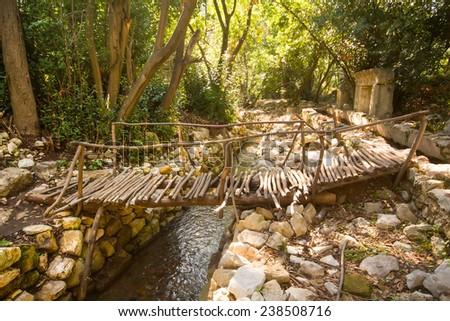 city ruins Olimpos bridge through a stream - stock photo