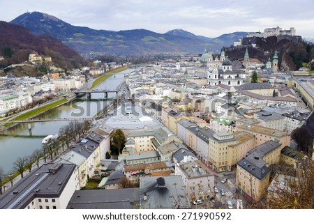 city Salzburg in Austria with castle, river and mountains - stock photo