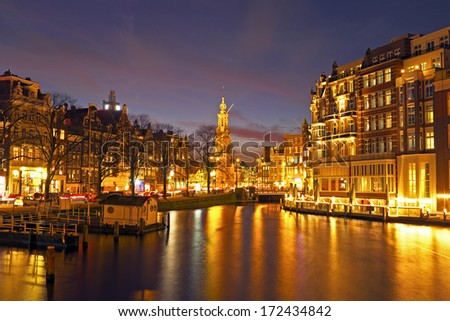 City scenic from Amsterdam in the Netherlands by night with the Munttower