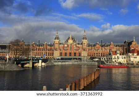 City scenic from Amsterdam in the Netherlands  with the central station - stock photo