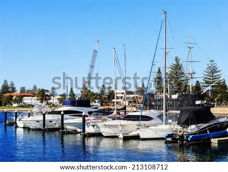 City seashore view with boats and yachts on sunny day - stock photo