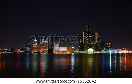 City skyline and lights with water reflection (Detroit) - stock photo