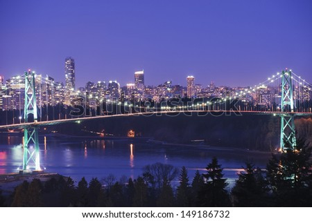 city skyline and Lions Gate Bridge spanning Burrard Inlet Vancouver British Columbia Canada - stock photo