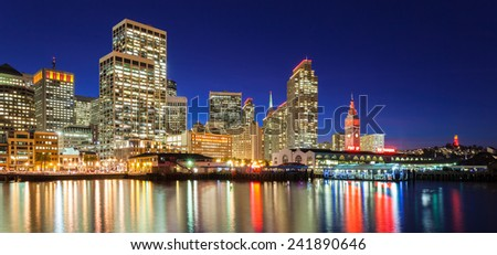 City skyline in San Francisco, California. Many buildings are illuminated with red and gold lights in honor of the 49ers making the NFL playoffs. - stock photo