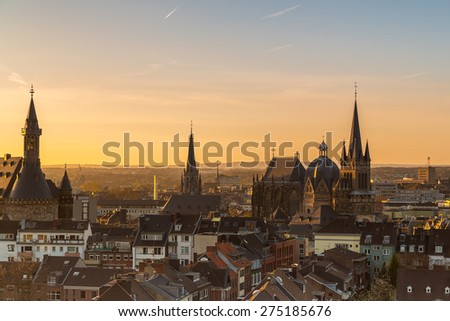 city skyline of aachen with cathedral and town hall at morning sunset - stock photo