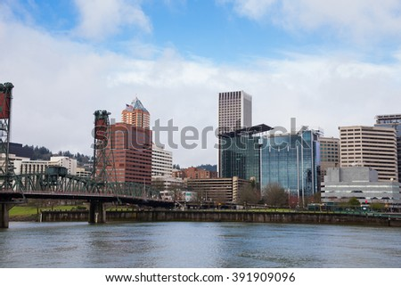 City skyline of downtown Portland Oregon in the Winter from across the river. - stock photo