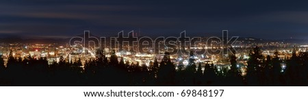 City skyline panorama taken at night in Eugene, Oregon. - stock photo