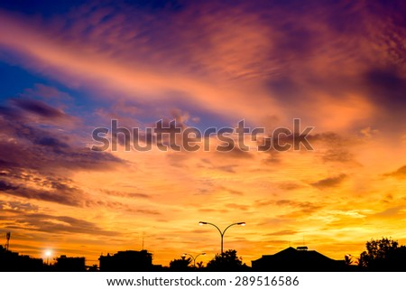 City skyline silhouetted against a blue sunset - stock photo