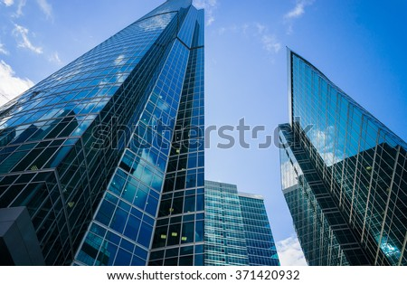 City Skyscrapers at cloudy summer day - stock photo
