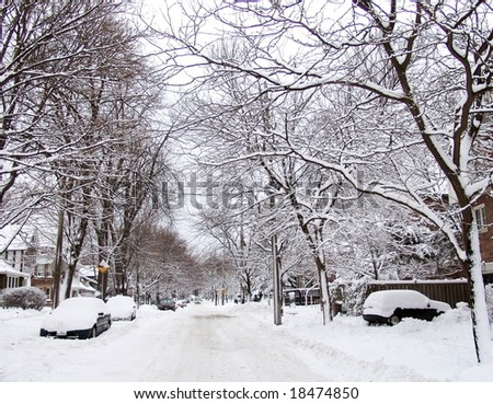 City street covered by snow after blizzard. Winter. Toronto, Canada. - stock photo