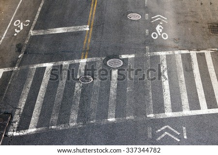 City street crosswalk and bike lanes in New York City - stock photo