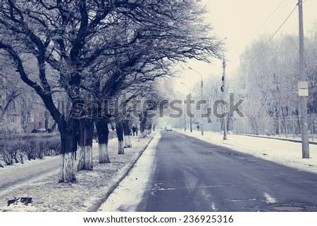 City street in snowy winter - stock photo