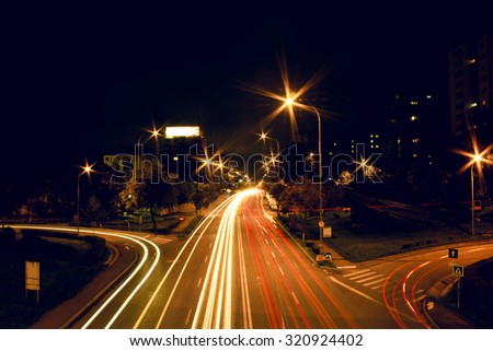 City traffic at in the middle of the night - stock photo