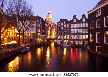 City view from Amsterdam at night in the Netherlands - stock photo